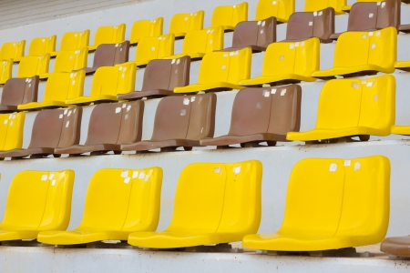 Seat grandstand yellow brown photo