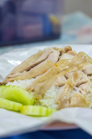 Hainanese chicken rice, steamed chicken and white rice photo
