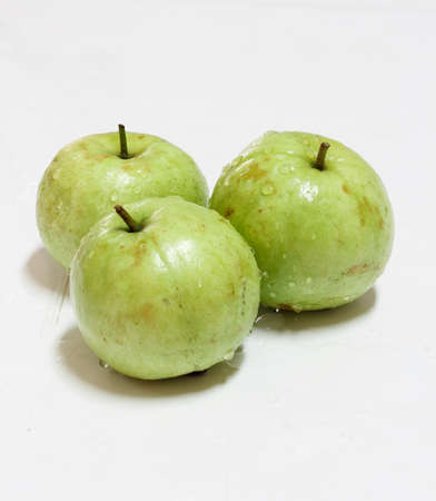 national fruit of china: Guava green fruit in the white background