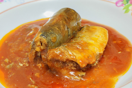 Canned fish in tomato sauce photo