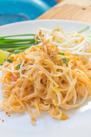 Noodles pad Thai is a thin rice noodles fried with tofu, vegetable, egg and peanuts Stock Photo - 28422920