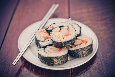 freeze dried: Close up of Rolled sushi rice on a white dish , Dark Vintage color filter