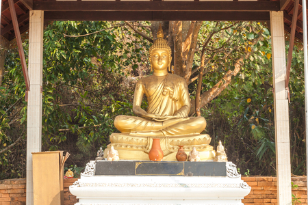 wood carvings: Buddhist art Stone ane Wood carvings Stock Photo