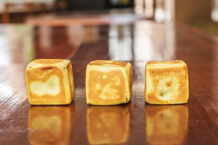 horizontal  green: Close up of cube red bean bun