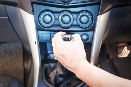 car transmission: Hand changing a car transmission