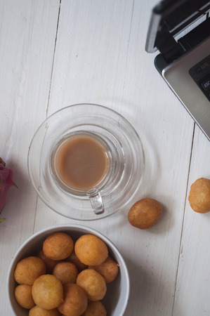 sweetmeat: coffee with sweetmeat and laptop