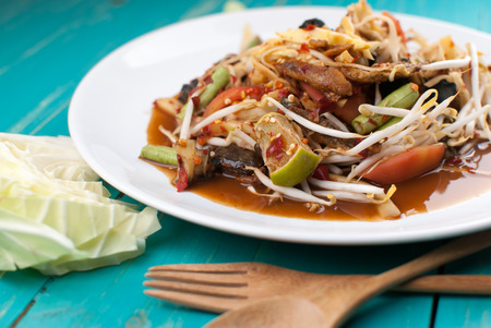 green papaya salad: Thai Spicy green papaya salad