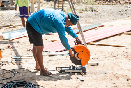 electric saw: PHITSANULOK - MAY 14: The smith are cutting steel with electric saw. on May 14, 2016 in Phitsanulok, Thailand.