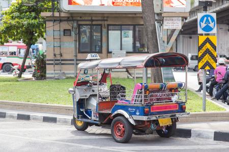 auto rickshaw: Auto rickshaw or tuk-tuk on the street of Bangkok.Tuk tuks are commonly used in transporting people and goods around the capital. Stock Photo