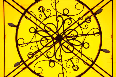 old lamp: Old lamp on a yellow background.