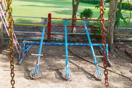 totter: vintage toy - seesaw on playground
