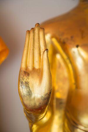 transcendental: Buddha golden statue blessing hand