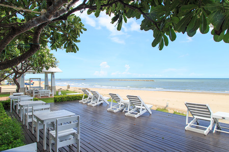 near: beach chairs on coast near ocean
