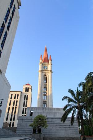 gothic style: Gothic style clock tower, Assumption University, Thailand.