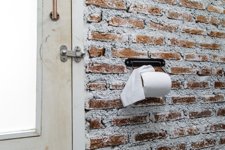 furl: bathroom tissue hang on the holder Stock Photo
