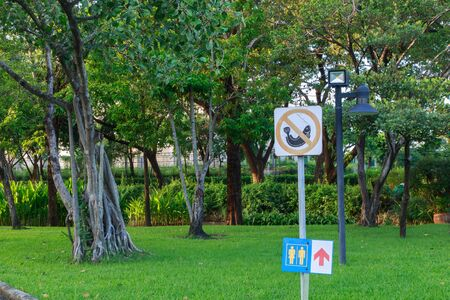fishing area: Signs in pubilc park it have no smoke, no walik in area no prohibited to trash no fishing. Stock Photo