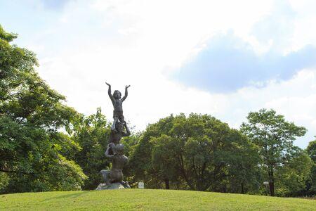 rot: Child image at garden in Vachirabenjatas Park (Rot Fai Park) Thailand