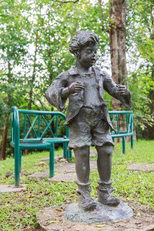 rot: Child image at garden in Vachirabenjatas Park Rot Fai Park Thailand Stock Photo
