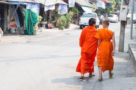 Buddhist monk walking on the street