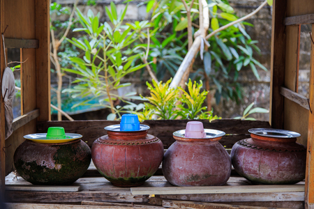Thai ancient pot with water dipper