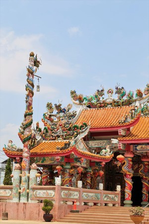 public domain: dragons on the roof of Chinese temple in Thailand, They are public domain Editorial