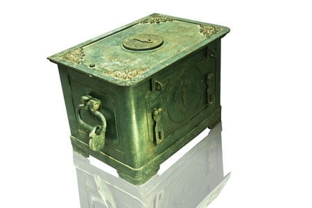 The old antique iron safe isolated on white Stock Photo - 12346323