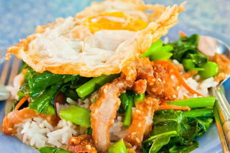 Thai food, kana moo krob  fried kale mixed crispy pork and egg