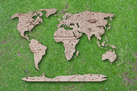 World map laterite on green moss background  photo