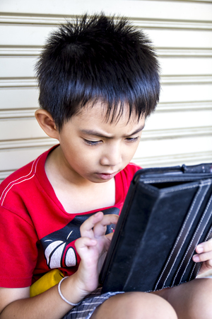 Young asian boy use to tablet  photo
