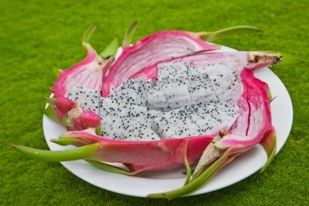 dragon fruits on green background  photo
