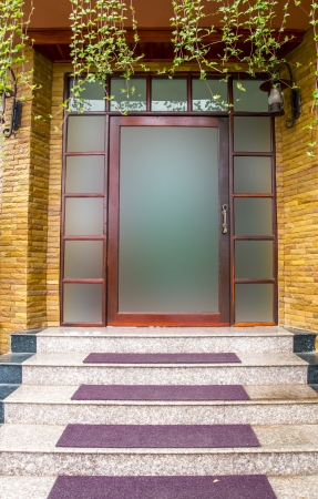 Glass door with building exterior is sandstone   photo
