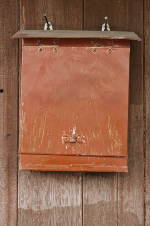 red post box  mailbox on wood  photo