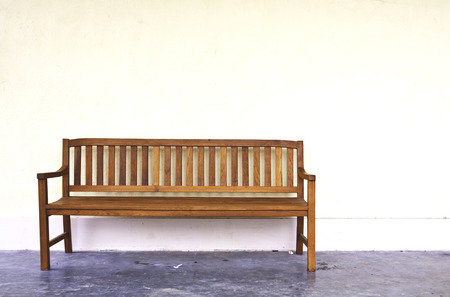 wood Bench Against blank Wall   photo