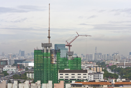 concrete commercial block: Construction site with a crane in the morning in middle town of bangkok,Thailand  Stock Photo
