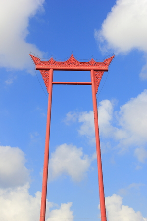 cha cha: the giant swing (sao ching cha) on the background of the sky and clouds in thailand