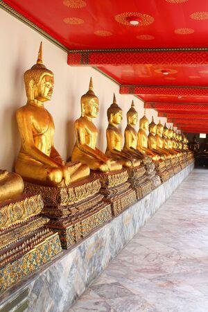 buddhist meditation: meditation buddha statues in buddhist temple wat pho, bangkok, thailand