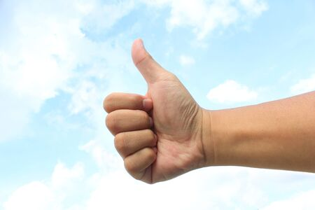 symbol of like  hand with thumb up on the sky background photo