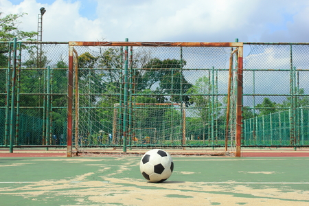 fűt�s: ball in front of futsal goal at outdoor futsal court during the daytime