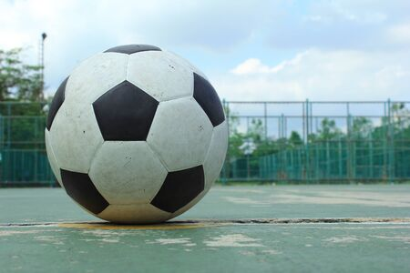 ball on the outdoor futsal court during the daytime. photo