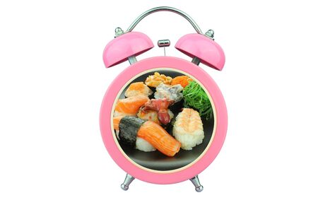 bell curve: conceptual art : sushi time : sushi within pink alarm clock isolated on white background