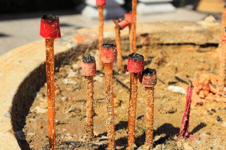 extinguish: background of extinguish big incense sticks in joss stick pot