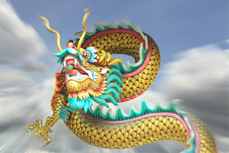 blurring: conceptual art : action zoom blurring effect of china dragon statue flying in the sky.