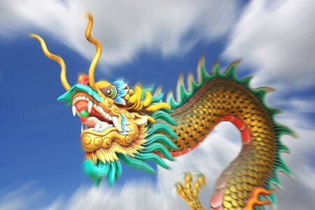 blurring: conceptual art : zoom blurring effect of china dragon statue flying in the sky.
