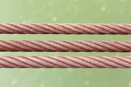 rusty wire: background of three rusty wire rope sling