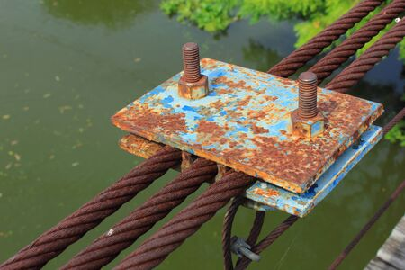 rusty wire: rusty wire rope sling background of the part of the bridge. Stock Photo