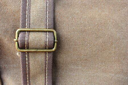 strap on: background and texture of brown fabric with strap
