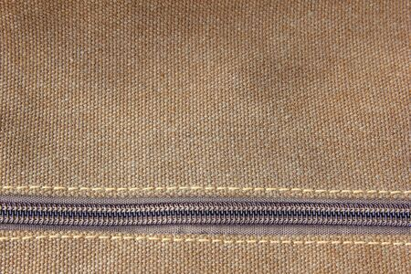haversack: closeup background of brown haversack zipper Stock Photo