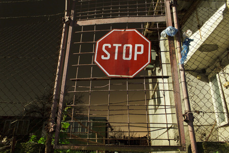 Stop sign on a door against thieves photo