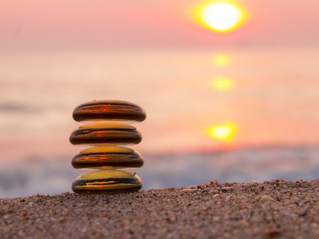 spring balance: Stack of zen stones on the beach