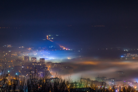 City under a thick fog shot from above